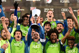COMMERCE CITY, CO - NOVEMBER 27:  Osvaldo Alonso #6 of Seattle Sounders holds up the MLS Western Conference Trophy after defeating the Colorado Rapids 1-0 at Dick's Sporting Goods Park on November 27, 2016 in Commerce City, Colorado.  (Photo by Harry How/Getty Images)
