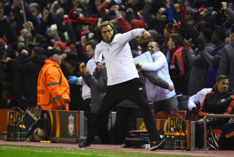 LIVERPOOL, ENGLAND - MARCH 10:  Jurgen Klopp, manager of Liverpool celebrates as Roberto Firmino of Liverpool scores their second goal during the UEFA Europa League Round of 16 first leg match between Liverpool and Manchester United at Anfield on March 10, 2016 in Liverpool, United Kingdom.  (Photo by Laurence Griffiths/Getty Images)