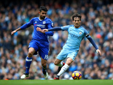 MANCHESTER, ENGLAND - DECEMBER 03:  David Silva of Manchester City and Diego Costa of Chelsea compete for the ball during the Premier League match between Manchester City and Chelsea at Etihad Stadium on December 3, 2016 in Manchester, England.  (Photo by Clive Brunskill/Getty Images)