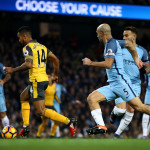 MANCHESTER, ENGLAND - DECEMBER 18: Theo Walcott of Arsenal (L) runs through to scores his sides first goal during the Premier League match between Manchester City and Arsenal at the Etihad Stadium on December 18, 2016 in Manchester, England.  (Photo by Clive Brunskill/Getty Images)