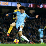MANCHESTER, ENGLAND - DECEMBER 18: Leroy Sane of Manchester City (C) scores his sides first goal during the Premier League match between Manchester City and Arsenal at the Etihad Stadium on December 18, 2016 in Manchester, England.  (Photo by Clive Brunskill/Getty Images)