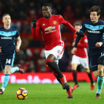 MANCHESTER, ENGLAND - DECEMBER 31:  Paul Pogba of Manchester United gets past the tackle from Marten de Roon of Middlesbrough during the Premier League match between Manchester United and Middlesbrough at Old Trafford on December 31, 2016 in Manchester, England.  (Photo by Matthew Lewis/Getty Images)