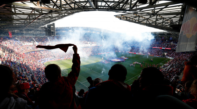 HARRISON, NJ - NOVEMBER 23:  Fans cheer during the antional anthem prior to the game between the New York Red Bulls and the New England Revolution during the Eastern Conference Final - Leg 1 at Red Bull Arena on November 23, 2014 in Harrison, New Jersey.  (Photo by Mike Stobe/Getty Images)