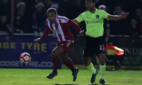 STOURBRIDGE, ENGLAND - DECEMBER 13: Luke Benbow of Stourbridge moves away from Lewin Nyatanga of Northampton Town during The Emirates FA Cup Second Round match between Stourbridge and Northampton Town at the War Memorial Athletic Ground on December 13, 2016 in Stourbridge, England.  (Photo by Pete Norton/Getty Images)
