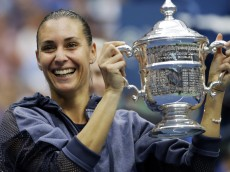 Flavia Pennetta, of Italy, holds up the championship trophy after beating Roberta Vinci, of Italy, in the women's championship match of the U.S. Open tennis tournament, Saturday, Sept. 12, 2015, in New York. (AP Photo/David Goldman) ORG XMIT: USO190