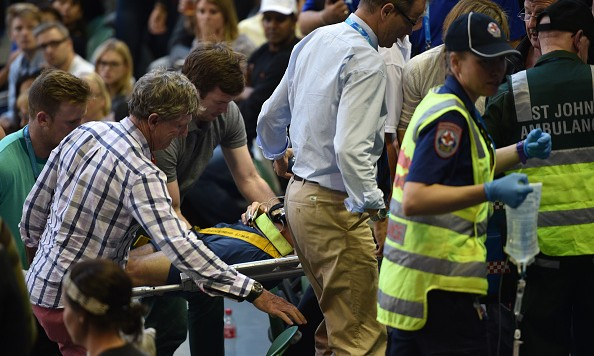Medical staff use a stretcher to carry Ana Ivanovic's coach Nigel Sears, from the stadium during the women's singles match between Serbia's Ana Ivanovic and Madison Keys of the US on day six of the 2016 Australian Open tennis tournament in Melbourne on January 23, 2016.