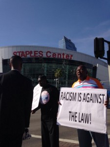 A fan protests Donald Sterling outside Game Five of the Clippers-Warriors game on April 29, 2014. Photo by Adam Hawk.