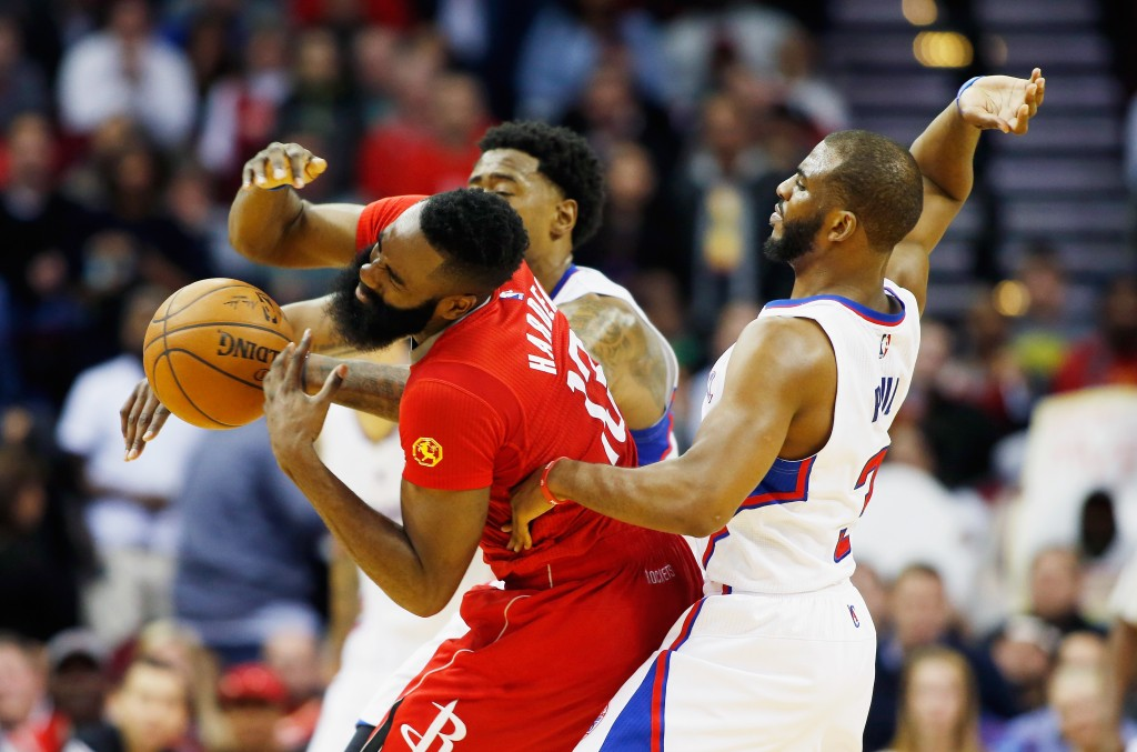 HOUSTON, TX - FEBRUARY 25:  James Harden #13 of the Houston Rockets is fouled by Chris Paul #3 of the Los Angeles Clippers during their game at the Toyota Center on February 25, 2015 in Houston, Texas. NOTE TO USER: User expressly acknowledges and agrees that, by downloading and/or using this photograph, user is consenting to the terms and conditions of the Getty Images License Agreement.  (Photo by Scott Halleran/Getty Images)