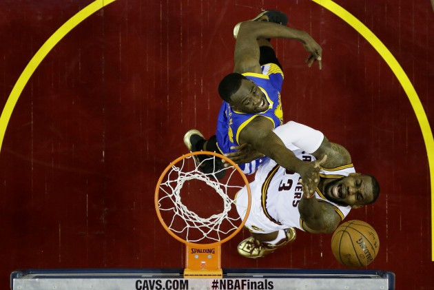 CLEVELAND, OH - JUNE 16:  LeBron James #23 of the Cleveland Cavaliers shoots against Draymond Green #23 of the Golden State Warriors in the first half during Game Six of the 2015 NBA Finals at Quicken Loans Arena on June 16, 2015 in Cleveland, Ohio. NOTE TO USER: User expressly acknowledges and agrees that, by downloading and or using this photograph, user is consenting to the terms and conditions of Getty Images License Agreement.  (Photo by Tony Dejak-Pool/Getty Images)