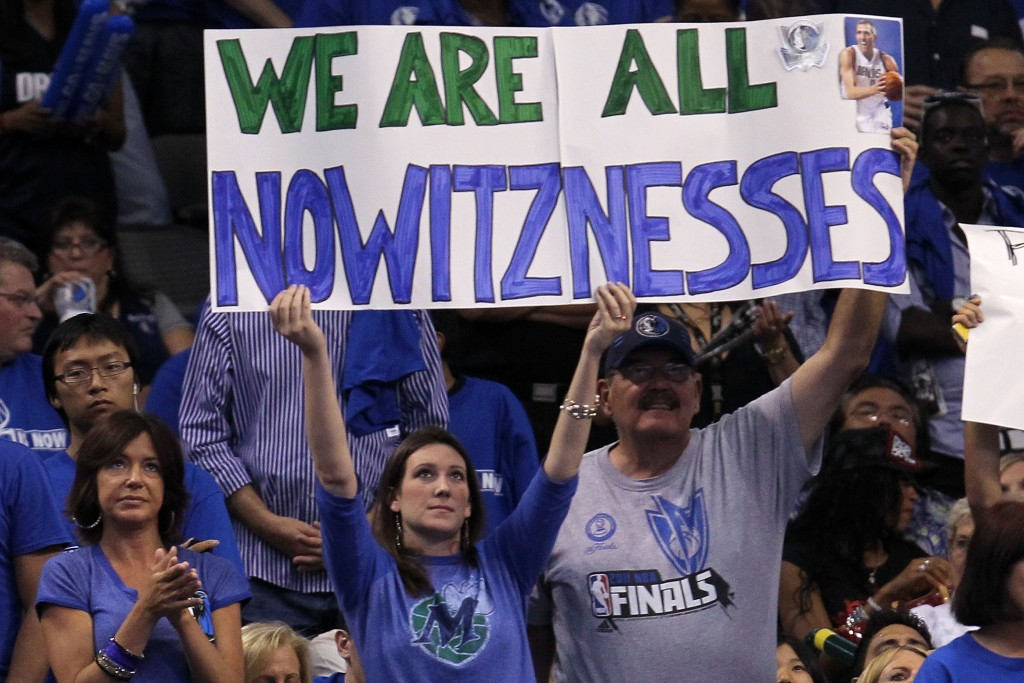"DALLAS, TX - JUNE 09:  Fans of the Dallas Mavericks hold up asign which reads  ""We are all Nowitznessess in reference to Dirk Nowitzki #41 of the Mavericks against the Miami Heat in Game Five of the 2011 NBA Finals at American Airlines Center on June 9, 2011 in Dallas, Texas.  NOTE TO USER: User expressly acknowledges and agrees that, by downloading and/or using this Photograph, user is consenting to the terms and conditions of the Getty Images License Agreement.  (Photo by Ronald Martinez/Getty Images)"