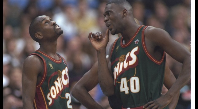 9 Feb 1997:  Seattle Supersonics forward Shawn Kemp (right) and guard Gary Payton confer during the NBA All-Star game in Cleveland, Ohio.  Mandatory Credit: Brian Bahr/Allsport