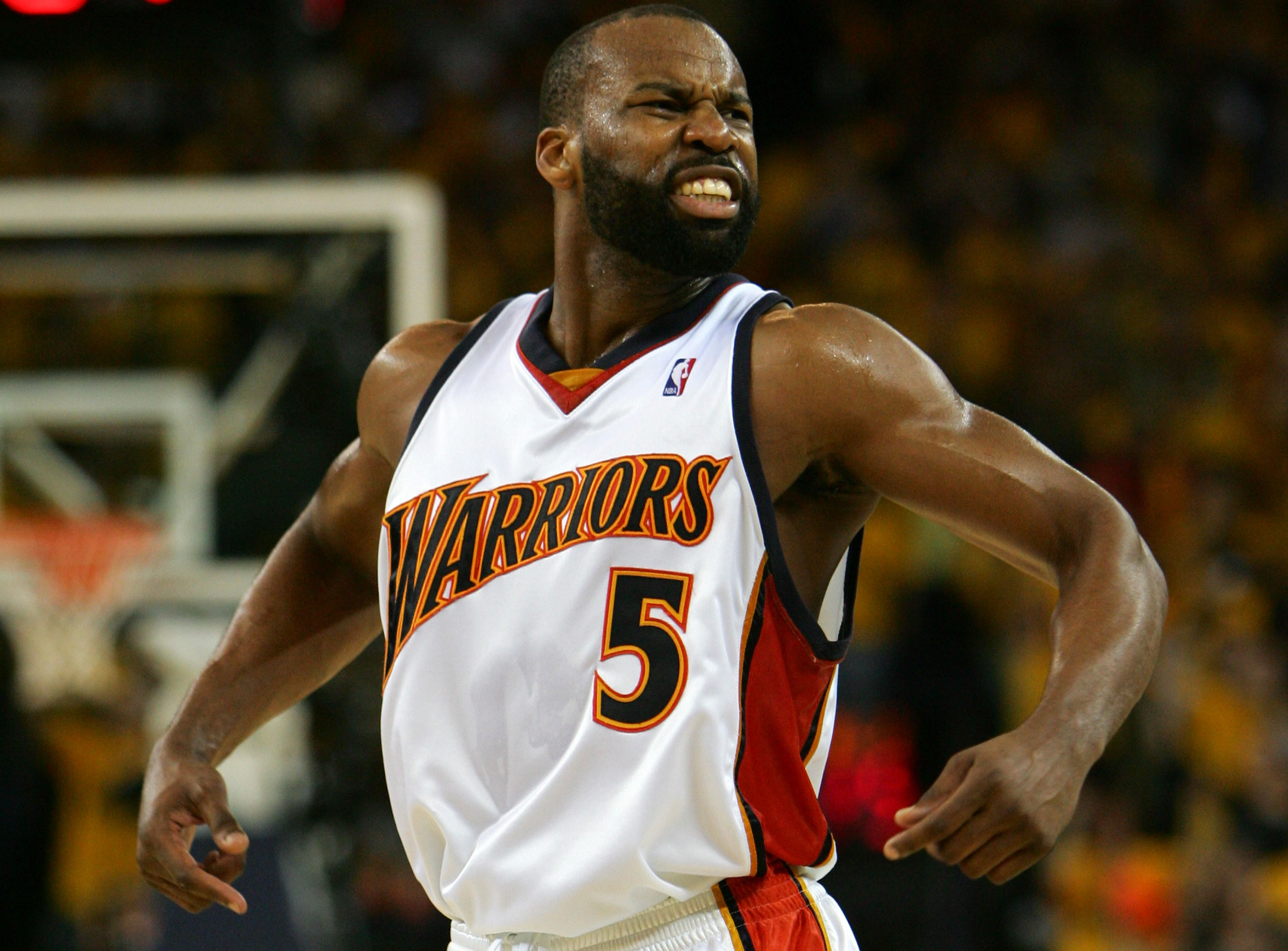 OAKLAND, CA - MAY 03:  Baron Davis #5 of the Golden State Warriors celebrates against the Dallas Mavericks in Game 6 of the Western Conference Quarterfinals during the 2007 NBA Playoffs on May 3, 2007 at Oracle Arena in Oakland, California. NOTE TO USER: User expressly acknowledges and agrees that, by downloading and or using this photograph, User is consenting to the terms and conditions of the Getty Images License Agreement.  (Photo by Jed Jacobsohn/Getty Images)