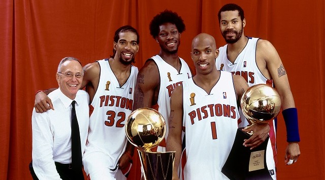 AUBURN HILLS, MI - JUNE 15:  (L-R) Head Coach Larry Brown, Richard Hamilton #32, Ben Wallace #3,  Chauncey Billups #1 and Rasheed Wallace #30 of the Detroit Pistons pose with the championship trophy after Game Five of the 2004 NBA Finals on June 15, 2004 at The Palace of Auburn Hills in Auburn Hills, Michigan. NOTE TO USER: User expressly acknowledges and agrees that, by downloading and/or using this Photograph, User is consenting to the terms and conditions of the Getty Images License Agreement.  Mandatory Copyright Notice: Copyright 2004 NBAE.  (Photo by Andrew D. Bernstein/NBAE via Getty Images)