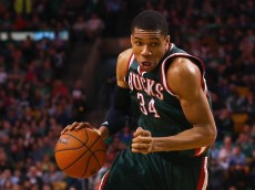 BOSTON, MA - APRIL 03:  Giannis Antetokounmpo #34 of the Milwaukee Bucks carries the ball against the Boston Celtics during the fourth quarter at TD Garden on April 3, 2015 in Boston, Massachusetts. The Bucks defeat the Celtics 110-101. NOTE TO USER: User expressly acknowledges and agrees that, by downloading and/or using this photograph, user is consenting to the terms and conditions of the Getty Images License Agreement.  (Photo by Maddie Meyer/Getty Images)