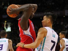 SHENZHEN, CHINA - OCTOBER 11: Lance Stephenson #1 of Los Angeles Clippers in action against Jeremy Lin #7 of Charlotte Hornets during the match between Charlotte Hornets and Los Angeles Clippers as part of the 2015 NBA Global Games China at Universiade Centre on October 11, 2015 in Shenzhen, China. (Photo by Zhong Zhi/Getty Images)
