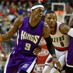 Sacramento Kings guard Rajon Rondo, left, dribbles past Portland Trail Blazers guard Damian Lillard during the first half of an NBA preseason basketball game in Portland, Ore., Monday, Oct. 5, 2015. (AP Photo/Craig Mitchelldyer)