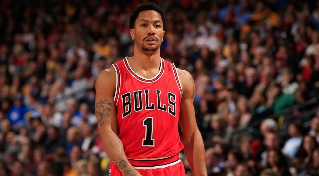 DENVER, CO - NOVEMBER 25:  Derrick Rose #1 of the Chicago Bulls looks on during a break in the action against the Denver Nuggets at Pepsi Center on November 25, 2014 in Denver, Colorado. The Nuggets defeated the Bulls 114-109. NOTE TO USER: User expressly acknowledges and agrees that, by downloading and or using this photograph, User is consenting to the terms and conditions of the Getty Images License Agreement.  (Photo by Doug Pensinger/Getty Images)