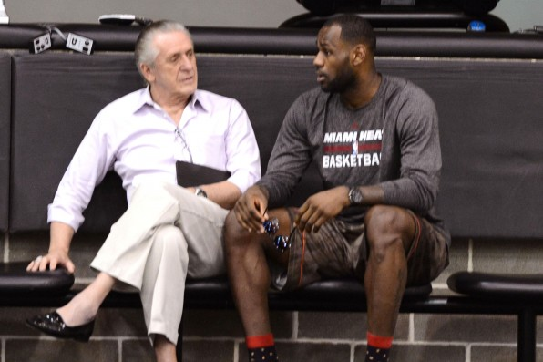 SAN ANTONIO, TX JUNE 6: Miami Heat owner Micky Arison, President Pat Riley and LeBron James speak during practice as part of the 2014 NBA Finals on June 6, 2014 at the Spurs Practice Facility in San Antonio, Texas. NOTE TO USER: User expressly acknowledges and agrees that, by downloading and or using this photograph, User is consenting to the terms and conditions of the Getty Images License Agreement. Mandatory Copyright Notice: Copyright 2014 NBAE (Photo by Garrett Ellwood/NBAE via Getty Images)