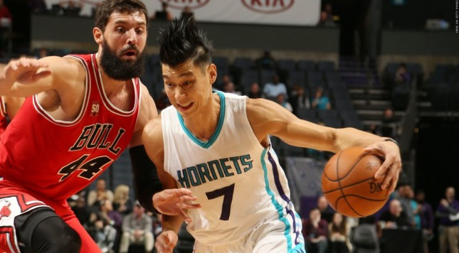CHARLOTTE, NC - OCTOBER 19:  Jeremy Lin #7 of the Charlotte Hornets handles the ball against Nikola Mirotic #44 of the Chicago Bulls during a preseason game at the Time Warner Cable Arena on October 19, 2015 in Charlotte, North Carolina. NOTE TO USER: User expressly acknowledges and agrees that, by downloading and or using this photograph, User is consenting to the terms and conditions of the Getty Images License Agreement.  Mandatory Copyright Notice:  Copyright 2015 NBAE (Photo by Kent Smith/NBAE via Getty Images)