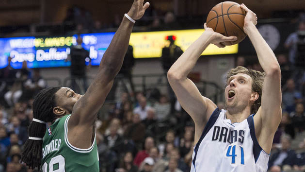 Jan 18, 2016; Dallas, TX, USA; Dallas Mavericks forward Dirk Nowitzki (41) shoots over Boston Celtics forward Jae Crowder (99) during the second half at the American Airlines Center. The Mavericks defeat the Celtics 118-113 in overtime. Mandatory Credit: Jerome Miron-USA TODAY Sports