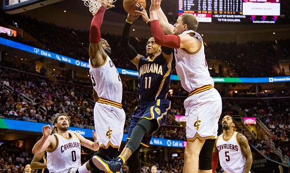 CLEVELAND, OH - FEBRUARY 29: Monta Ellis #11 of the Indiana Pacers shoots over LeBron James #23 and Timofey Mozgov #20 of the Cleveland Cavaliers during the first half at Quicken Loans Arena on February 29, 2016 in Cleveland, Ohio. NOTE TO USER: User expressly acknowledges and agrees that, by downloading and/or using this photograph, user is consenting to the terms and conditions of the Getty Images License Agreement. Mandatory copyright notice. (Photo by Jason Miller/Getty Images)