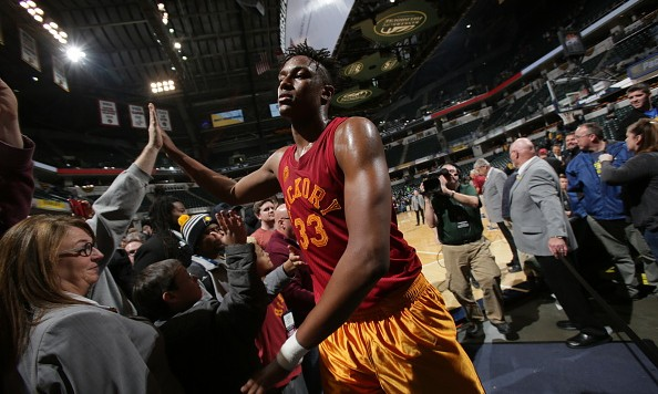 INDIANAPOLIS, IN - FEBRUARY 24: Myles Turner #33 of the Indiana Pacers high fives fans after the win against the New York Knicks on February 24, 2016 at Bankers Life Fieldhouse in Indianapolis, Indiana. NOTE TO USER: User expressly acknowledges and agrees that, by downloading and or using this Photograph, user is consenting to the terms and conditions of the Getty Images License Agreement. Mandatory Copyright Notice: Copyright 2016 NBAE (Photo by Rob Hoskins/NBAE via Getty Images)