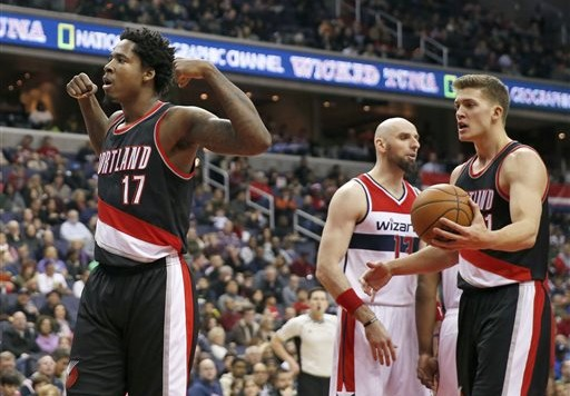 Portland Trail Blazers center Ed Davis (17) reacts after a play with forward Meyers Leonard (11) nearby, in the first half of an NBA basketball game against the Washington Wizards, Monday, Jan. 18, 2016, in Washington. (AP Photo/Alex Brandon)