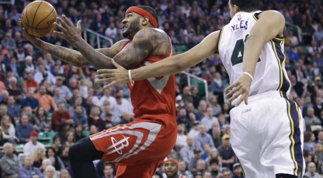 Houston Rockets center Josh Smith goes to the basket as Utah Jazz forward Trey Lyles (41) defends during the second quarter of an NBA basketball game Tuesday, Feb. 23, 2016, in Salt Lake City. (AP Photo/Rick Bowmer)