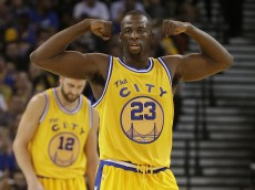 In this Nov. 24, 2015 photo, Golden State Warriors forward Draymond Green (23) gestures during the second half of an NBA basketball game against the Los Angeles Lakers in Oakland, Calif. Green pounds his chest with his right fist and roars toward the rafters after big plays, mouth agape. Over all of the tough years and long odds, he has earned it and Jason Richardson loves seeing that display of emotion. (AP Photo/Jeff Chiu)