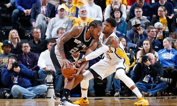 INDIANAPOLIS, IN - MARCH 7: Kawhi Leonard #2 of the San Antonio Spurs handles the ball against Paul George #13 of the Indiana Pacers in the first half of the game at Bankers Life Fieldhouse on March 7, 2016 in Indianapolis, Indiana. NOTE TO USER: User expressly acknowledges and agrees that, by downloading and or using the photograph, User is consenting to the terms and conditions of the Getty Images License Agreement. (Photo by Joe Robbins/Getty Images)