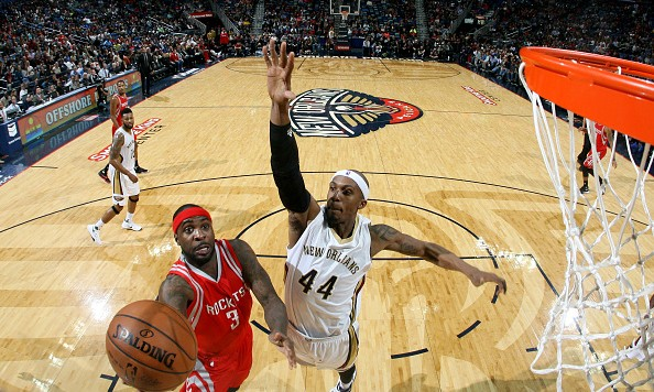 NEW ORLEANS, LA - JANUARY 25:  Ty Lawson #3 of the Houston Rockets goes to the basket against Dante Cunningham #44 of the New Orleans Pelicans on January 25, 2016 at the Smoothie King Center in New Orleans, Louisiana. NOTE TO USER: User expressly acknowledges and agrees that, by downloading and or using this Photograph, user is consenting to the terms and conditions of the Getty Images License Agreement. Mandatory Copyright Notice: Copyright 2016 NBAE (Photo by Layne Murdoch Jr./NBAE via Getty Images)