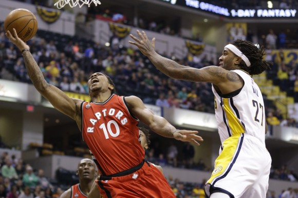 Toronto Raptors guard DeMar DeRozan (10) shoots next to Indiana Pacers center Jordan Hill (27) during the first half of an NBA basketball game in Indianapolis, Thursday, March 17, 2016. (AP Photo/Michael Conroy)