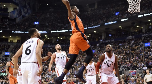 Oklahoma City Thunder's Kevin Durant soars in to dunk against the Toronto Raptors during second half NBA basketball action in Toronto on Monday, March 28, 2016. (Frank Gunn/The Canadian Press via AP)