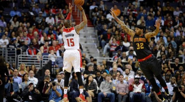 Mar 23, 2016; Washington, DC, USA;Washington Wizards forward Marcus Thornton (15) shoots the ball over Atlanta Hawks forward Mike Scott (32) during the second half at Verizon Center. The Hawks won 122-101. Mandatory Credit: Tommy Gilligan-USA TODAY Sports