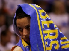 OKLAHOMA CITY, OK - MAY 22: Stephen Curry #30 of the Golden State Warriors covers his face in the fourth quarter against the Oklahoma City Thunder in game three of the Western Conference Finals during the 2016 NBA Playoffs at Chesapeake Energy Arena on May 22, 2016 in Oklahoma City, Oklahoma. (Photo by Ronald Martinez/Getty Images)