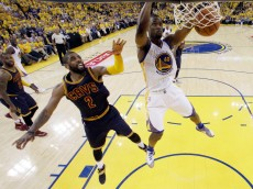 Golden State Warriors' Harrison Barnes (40) dunks past Cleveland Cavaliers' Kyrie Irving (2) during the second half in Game 1 of basketball's NBA Finals Thursday, June 2, 2016, in Oakland, Calif. (AP Photo/Marcio Jose Sanchez, Pool)