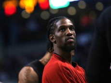 BOSTON, MA - APRIL 13: Briante Weber #12 of the Miami Heat looks on during a timeout against the Boston Celtics at TD Garden on April 13, 2016 in Boston, Massachusetts. NOTE TO USER: User expressly acknowledges and agrees that, by downloading and/or using this photograph, user is consenting to the terms and conditions of the Getty Images License Agreement.  (Photo by Mike Lawrie/Getty Images)