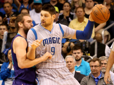 ORLANDO, FL - JANUARY 22:  Nikola Vucevic #9 of the Orlando Magic looks to pass against Spencer Hawes #00 of the Charlotte Hornets during the game at Amway Center on January 22, 2016 in Orlando, Florida. NOTE TO USER: User expressly acknowledges and agrees that, by downloading and/or using this Photograph, user is consenting to the terms and conditions of the Getty Images License Agreement.  (Photo by Sam Greenwood/Getty Images)