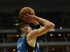 DALLAS, TX - FEBRUARY 28:  Zach LaVine #8 of the Minnesota Timberwolves takes a shot against the Dallas Mavericks at American Airlines Center on February 28, 2016 in Dallas, Texas.  NOTE TO USER: User expressly acknowledges and agrees that, by downloading and or using this photograph, User is consenting to the terms and conditions of the Getty Images License Agreement.  (Photo by Ronald Martinez/Getty Images)
