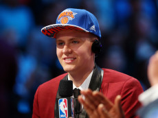 NEW YORK, NY - JUNE 25:  Kristaps Porzingis speaks to the media after being selected fourth overall by the New York Knicks in the First Round of the 2015 NBA Draft at the Barclays Center on June 25, 2015 in the Brooklyn borough of  New York City. NOTE TO USER: User expressly acknowledges and agrees that, by downloading and or using this photograph, User is consenting to the terms and conditions of the Getty Images License Agreement.  (Photo by Elsa/Getty Images)