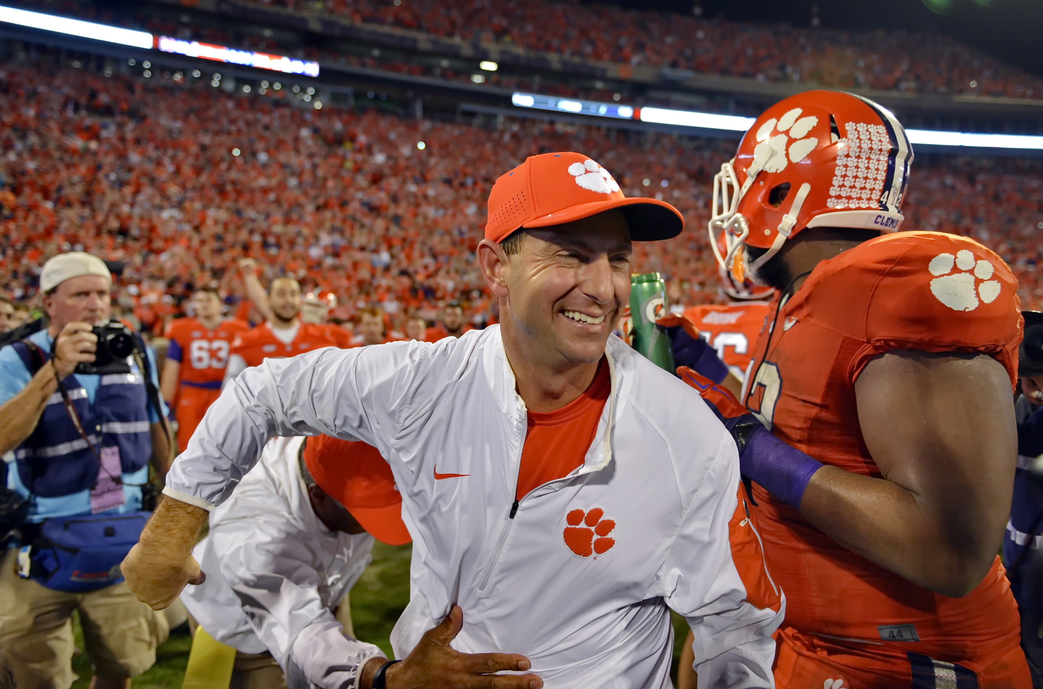 FILE - In this Nov. 7, 2015, file photo, Clemson head coach Dabo Swinney celebrates after their 23-17 win over Florida State in an NCAA college football game in Clemson,  S.C. Swinney has been named the AP coach of the year, Monday, Dec. 21, after leading the Tigers to an undefeated season and spot in the College Football Playoffs. (AP Photo/Richard Shiro, File)
