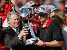 HOUSTON, TX - DECEMBER 05:  Michael Aresco, Commissioner of the AAC hands head coach Tom Herman of the Houston Cougars the AAC Championship trophy after defeating the Temple Owls 24-13 at TDECU Stadium on December 5, 2015 in Houston, Texas.  (Photo by Bob Levey/Getty Images)