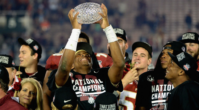 PASADENA, CA - JANUARY 06:  Quarterback Jameis Winston #5 of the Florida State Seminoles holds the Coaches' Trophy after defeating the Auburn Tigers 34-31 in the 2014 Vizio BCS National Championship Game at the Rose Bowl on January 6, 2014 in Pasadena, California.  (Photo by Harry How/Getty Images)