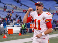 BALTIMORE, MD - DECEMBER 20:  Quarterback Alex Smith #11 of the Kansas City Chiefs celebrates while running off the field following the Chiefs 34-14 win over the Baltimore Ravens at M&T Bank Stadium on December 20, 2015 in Baltimore, Maryland.  (Photo by Rob Carr/Getty Images)