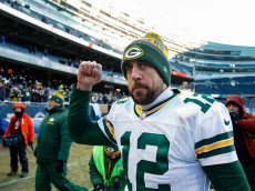 CHICAGO, IL - DECEMBER 18:  Quarterback Aaron Rodgers #12 of the Green Bay Packers walks off the field after the Packers win at Soldier Field on December 18, 2016 in Chicago, Illinois. The Green Bay Packers defeated the Chicago Bears 30-27.  (Photo by Joe Robbins/Getty Images)