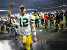 DETROIT, MI - JANUARY 1: Quarterback Aaron Rodgers #12 of the Green Bay Packers raises his fist as he leaves the field after defeating the Detroit Lions 31-24 at Ford Field on January 1, 2017 in Detroit, Michigan (Photo by Gregory Shamus/Getty Images)