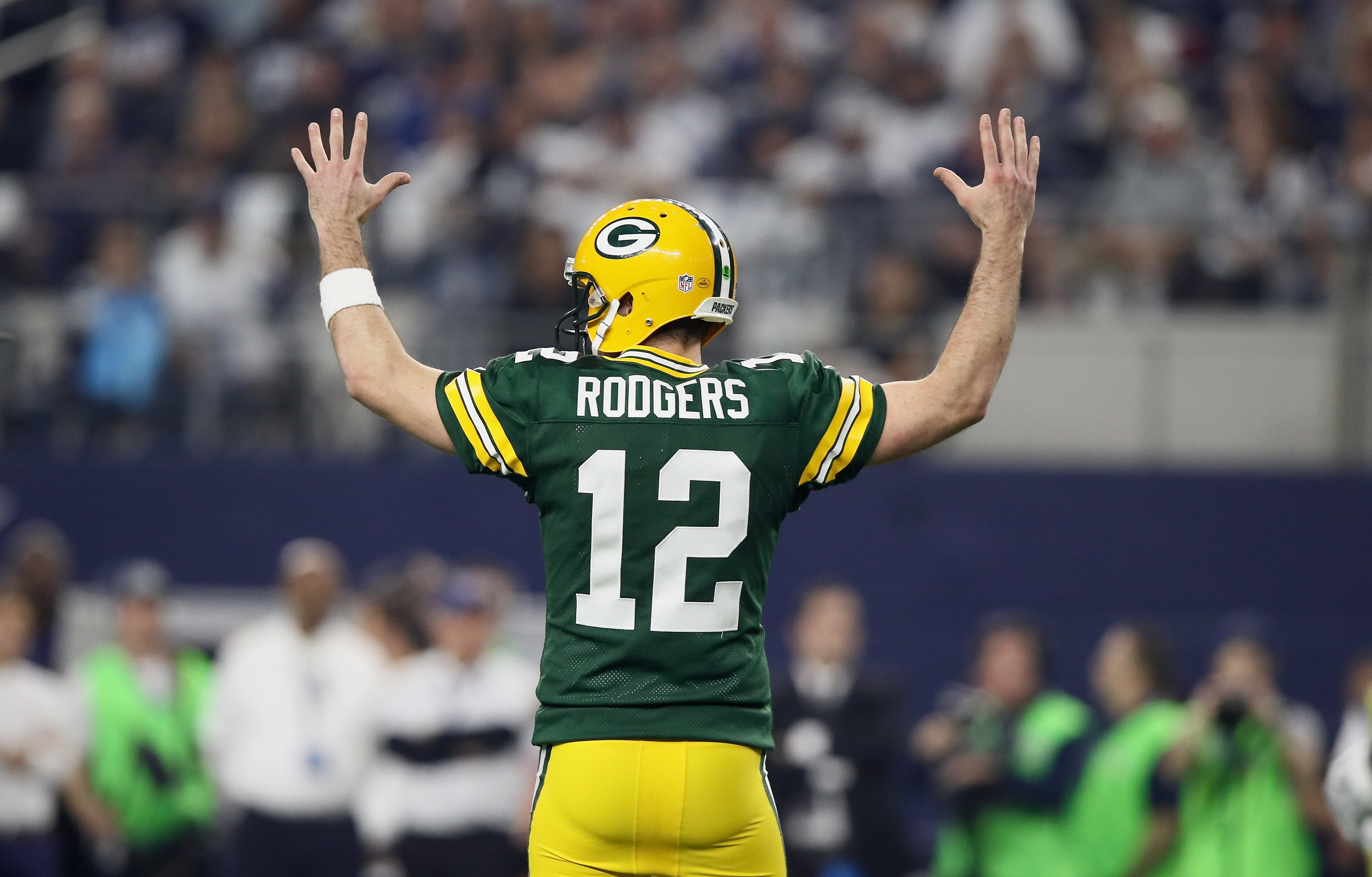 ARLINGTON, TX - JANUARY 15:  Aaron Rodgers #12 of the Green Bay Packers reacts after the Packers scored a touchdown against the Dallas Cowboys during the NFC Divisional Playoff Game at AT&T Stadium on January 15, 2017 in Arlington, Texas.  (Photo by Ezra Shaw/Getty Images)