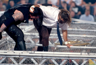 Mankind_vs_The_Undertaker_Hell_in_a_Cell_Match_King_of_the_Ring_1998-e14773217606141