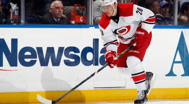 UNIONDALE, NY - JANUARY 04: Alexander Semin #28 of the Carolina Hurricanes skates against the New York Isalnders at the Nassau Veterans Memorial Coliseum on January 4, 2014 in Uniondale, New York. The Hurricanes defeated the Islanders 3-2.  (Photo by Bruce Bennett/Getty Images)