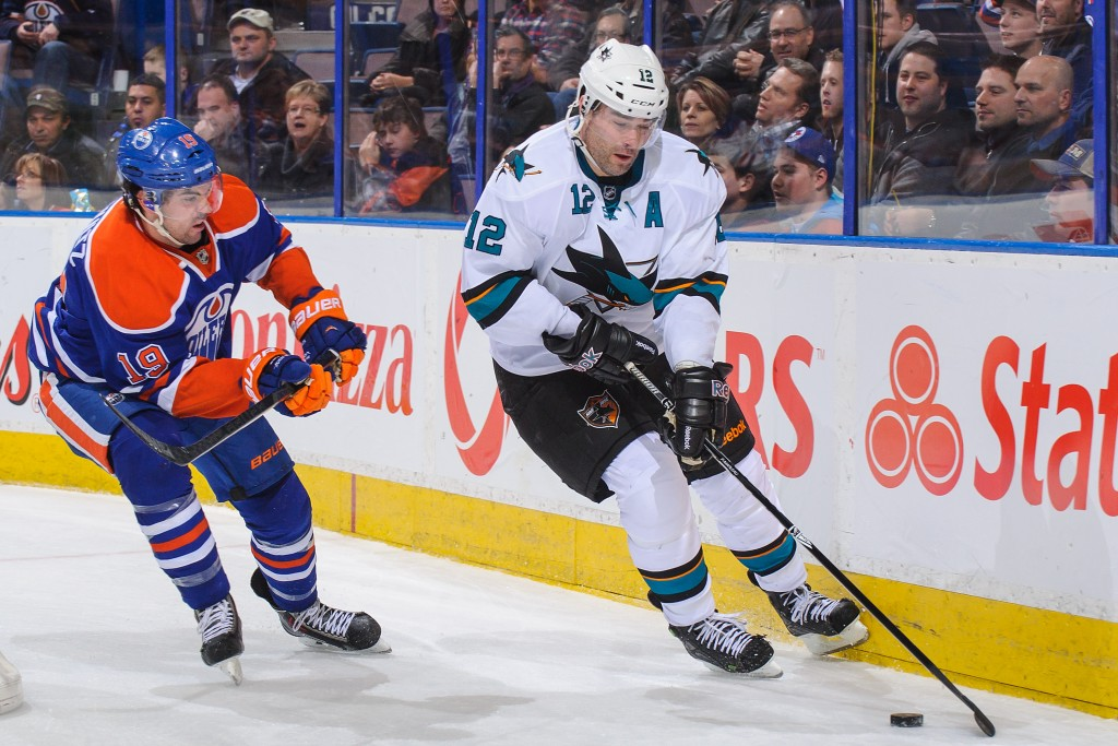 EDMONTON, AB - JANUARY 29: Justin Schultz #19 of the Edmonton Oilers chases Patrick Marleau #12 of the San Jose Sharks during an NHL game at Rexall Place on January 29, 2014 in Edmonton, Alberta, Canada. The Oilers defeated the Sharks 3-0. (Photo by Derek Leung/Getty Images)